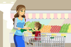 Grocery shopping. A vector illustration of a mother and her son going grocery shopping royalty free illustration
