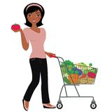Grocery Shopping. African american woman with healthy veg in shopping cart Royalty Free Stock Photography