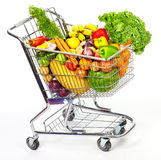 Grocery shopping cart with vegetables and fruits. Royalty Free Stock Image