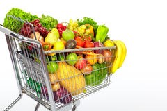 Grocery shopping cart with vegetables and fruits. Stock Photo