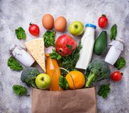 Healthy organic products with paper bag. Grocery shopping concept. Healthy organic products with paper bag.Top view, copy space Stock Photos