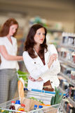 Grocery shopping store - Attractive woman Stock Photography