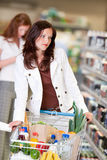 Grocery shopping store - Beautiful brunette woman Stock Image