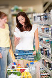 Grocery shopping store - Beautiful brunette woman Stock Photo