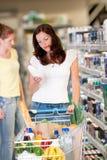 Grocery shopping store - Beautiful brunette woman Stock Photo