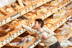 Grocery shopping store - Boy buying bread Stock Photo