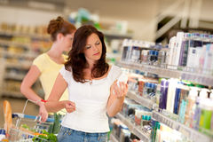 Grocery shopping store - Brown hair woman Stock Photo