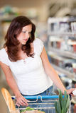 Grocery shopping store - Brown hair woman Royalty Free Stock Photo