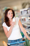 Grocery shopping store - Brunette woman  Royalty Free Stock Image