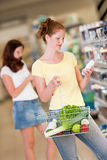 Grocery shopping store - Red hair woman Stock Photography