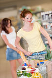 Grocery shopping store - Red hair woman  Royalty Free Stock Images