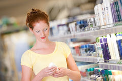Grocery shopping store - Red hair woman Royalty Free Stock Image