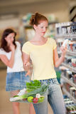 Grocery shopping store - Red hair woman Stock Photos