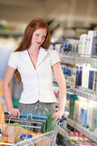 Grocery shopping store - Red hair woman Royalty Free Stock Photo