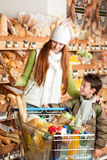 Grocery shopping store - Red hair woman with child Stock Image