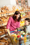 Grocery shopping store - Woman with child Stock Photos