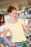 Grocery shopping store - Woman in supermarket Stock Image
