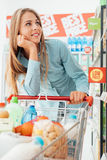 Grocery shopping at the supermarket Royalty Free Stock Images