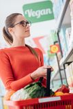 Grocery shopping at the supermarket stock images