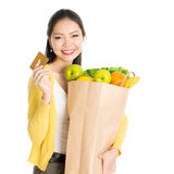 Grocery shopping woman and credit card Royalty Free Stock Photography