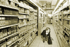 Grocery store. Woman in grocery store stock photo