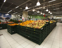 Grocery store. Apples in the foreground Royalty Free Stock Photo