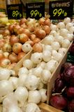 Grocery Store Bins Full of Yellow, White and Red Onions Stock Photos