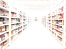 Store blurred background. Blurred alcohol market royalty free stock image