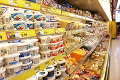 Grocery store cheese shelves Stock Image