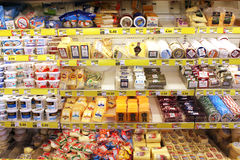 Grocery store cheese shelves Stock Images