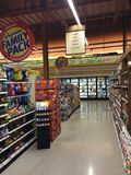 Grocery store interior candy aisle, dairy case in back Stock Image