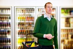 Grocery Store Man. Portrait of a man looking at the camera in a grocery store stock image