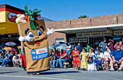 Grocery store mascot in parade stock image