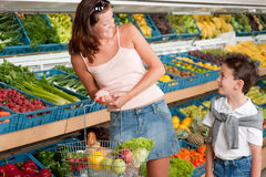Grocery store - Mother with child stock images