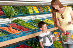 Grocery store - Red hair woman with child Stock Photo