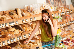 Grocery store: Red hair woman with mobile phone Stock Image