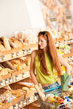 Grocery store: Red hair woman with shopping cart Stock Images