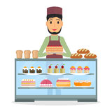 Grocery store seller with cake. Stock Image