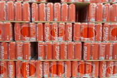 Grocery store shelf with cans of coca cola classical. SINGAPORE- NOV 11, 2017: Grocery store shelf with cans of coca cola classical. Coke products were sold in Stock Image