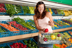 Grocery store - Smiling woman Stock Image