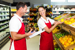 Grocery store staff with clipboard Royalty Free Stock Image