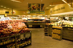Grocery store supermarket. A well organized grocery store with nice interiors and wooden floor. It has a huge variety of fruits and vegetables Stock Images
