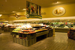 Grocery store supermarket. A well organized grocery store with nice interiors and wooden floor. It has a huge variety of fruits and vegetables Stock Photography