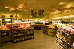 Grocery store supermarket. A well organized grocery store with nice interiors and wooden floor. It has a huge variety of fruits and vegetables Royalty Free Stock Photos