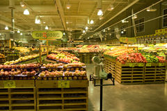 Grocery store supermarket. A well organized grocery store with huge variety of fruits and vegetables Royalty Free Stock Image