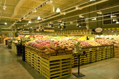 Grocery store supermarket. A well organized grocery store with huge variety of fruits and vegetables Royalty Free Stock Photography