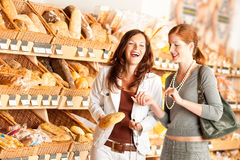 Grocery store: Two women choosing bread Stock Photo