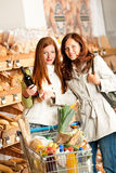 Grocery store: Two young women Royalty Free Stock Photo