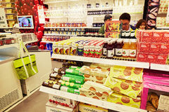 Grocery store retail shop shopping. Various kinds of goods on sale in grocery store. People shopping in grocery retail shop Royalty Free Stock Image