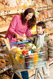 Grocery store - Woman with child stock photos
